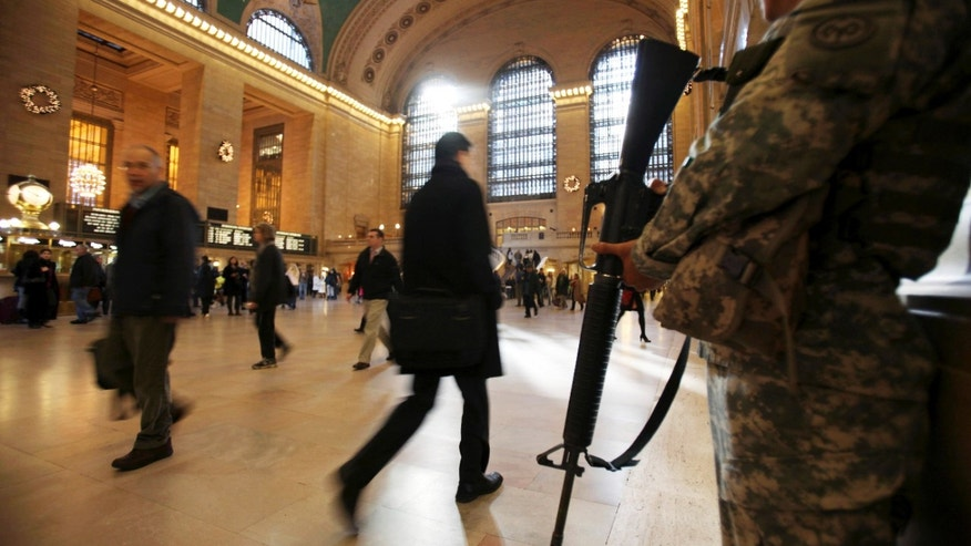 Nov. 24: National Guard security personnel watch as travelers make their way through Grand Central Station in New York. As the holiday tourist season begins in New York City, there are reminders everywhere of how being the country's main target for terrorism has gradually changed this city.