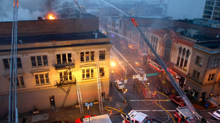 Dec. 6: Firefighters work to control a massive blaze in the 400 block of Baltimore Street in downtown Baltimore known as The Block.
