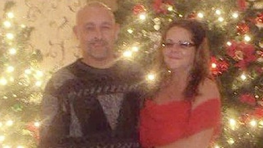 Tanya Shannon, of Ransom, Ill., is believed to have been riding with her husband, Dale, 41, when their car crashed roughly six miles from their home shortly after leaving a holiday party in nearby Streator, according to LaSalle County Sheriff Thomas Templeton. The couple is seen here at a Christmas party just hours before the fatal wreck.  (Handout)