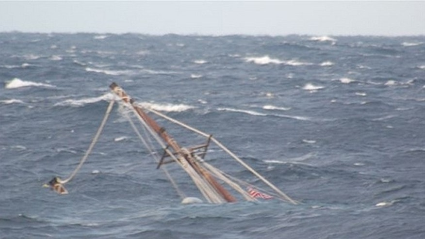 In this photo released by the U.S. Coast Guard, a mast of the 88-foot sailing vessel Raw Faith protrudes from the water as the boat sinks in approximately 6,000 feet of water about 166 miles southeast of Cape Cod, Mass., on Wednesday. The crew of the Kittery, Maine, Coast Guard Cutter Reliance remained on scene until the vessel sank. (U.S. Coast Guard)
