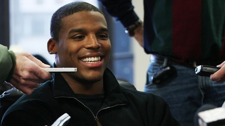 Heisman candidate Cam Newton, quarterback for Auburn, speaks to reporters during a news conference on Friday
