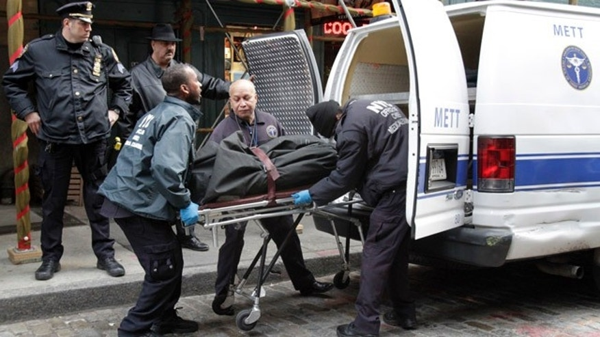 Dec. 11: Members of the Office of the Chief Medical Examiner use a stretcher remove the body of Mark Madoff from the apartment building in which he lived in the Soho neighborhood of New York.