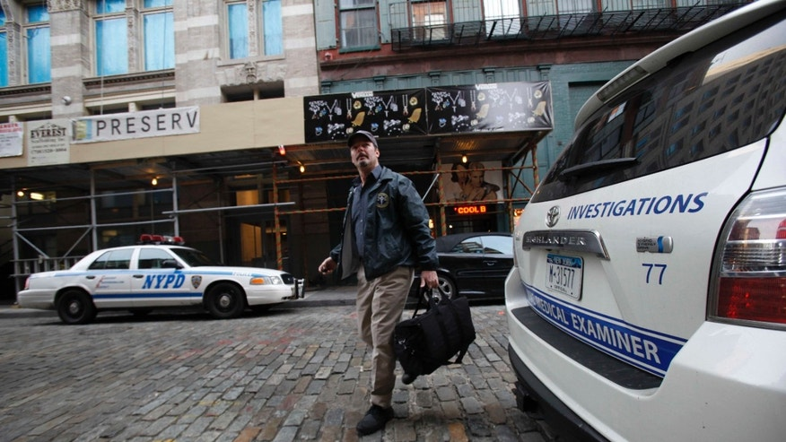 Dec. 11: A medical examiner arrives at the apartment building where Mark Madoff lived in New York. Mark, one of Bernard Madoff's sons, was found dead of an apparent suicide, according to a law enforcement official.