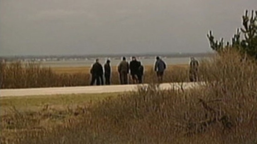 Suffolk County police search a deserted beach on New York's Long Island after finding finding the remains of four people (MyFoxNY.com)