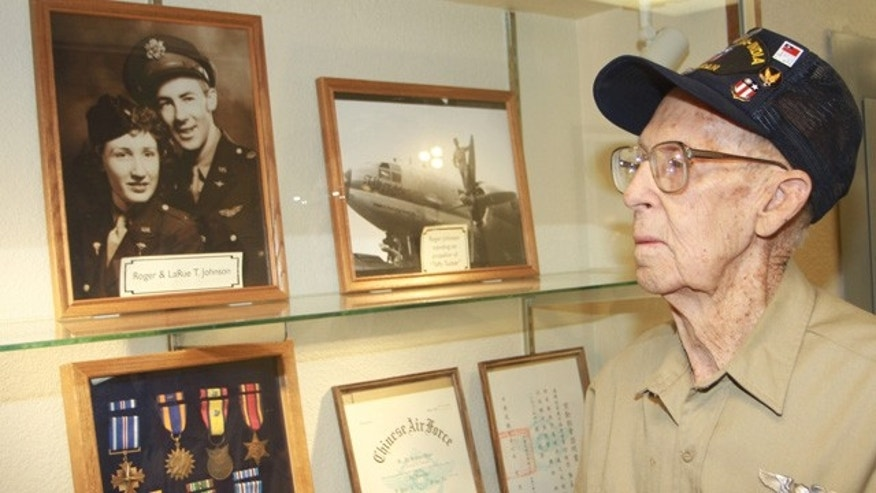 Roger Johnson, 90, hopes his exhibit of World War II memorabilia will inspire students at Utah's Snow College. A $40,000 endowment fund has been created to honor him and his late wife, LaRue.  (Snow College)