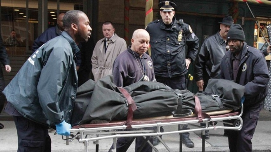Dec. 11, 2010: Medical examiner staff remove the body of Mark Madoff from his apartment in the Soho neighborhood of New York