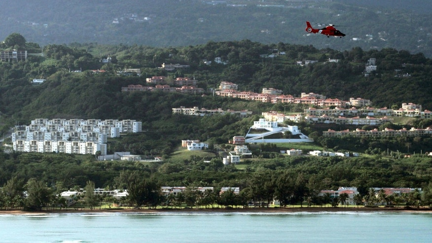 Dec. 21: A U.S. Coast Guard helicopter flies over an area believed to be the crash site of a Puerto Rico National Guard helicopter in Rio Grande, Puerto Rico. The Puerto Rico National Guard helicopter crashed into the ocean the previous day on a drug raid mission with six people aboard.