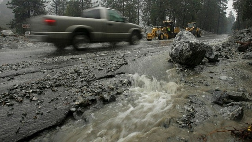 Dec. 21: The main road into Forest Falls is reopened after bulldozers cleared debris from several days of rain on Tuesday in Forest Falls, Calif. Forecasters expect heavy rains across California going into Wednesday. (AP/The Press-Enterprise)