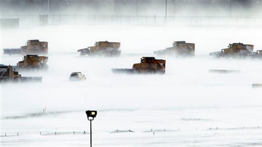 Dec. 27, 2010: Snow removal crews work to clear runways at Philadelphia International Airport. A powerful East Coast blizzard menaced would-be travelers by air, rail and highway, leaving thousands without a way to get home after the holidays and shutting down major airports and rail lines for days.