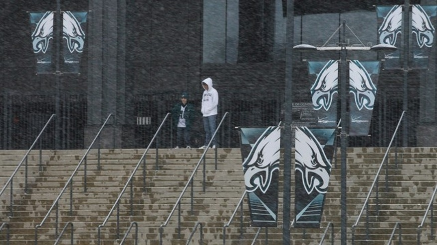 Dec. 26, 2010: Fans walk around Lincoln Financial Field, home of the Philadelphia Eagles football team, as snow falls in Philadelphia.