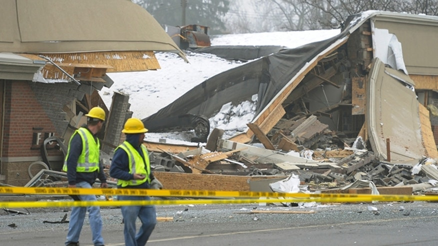 Dec. 29: Emergency personnel are on the scene after an explosion and collapse at the William C. Franks furniture store in Wayne, Mich.