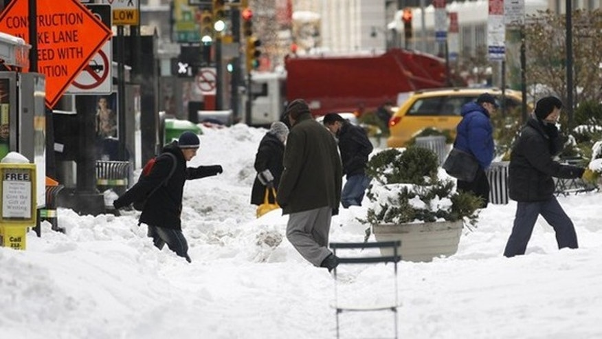 Dec. 28, 2010: Pedestrians cross a snow covered portion of Broadway in New York's Times Square (Reuters).