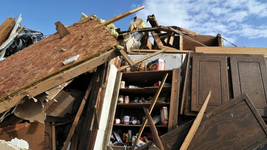 Dec. 31, 2010: Canned goods lie inside the pantry of a home destroyed by a tornado that tore through the small town of Cincinnati, Ark., on New Year's Eve.