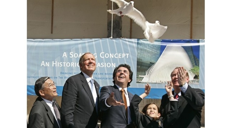 Spanish architect Santiago Calatrava, center, and his daughter Sofia release two doves at a ceremony to launch construction of the World Trade Center Transit Hub.