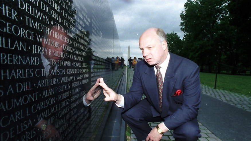 In this May 17, 1994 file photo, John Wheeler lll touches the name of a friend engraved in the Vietnam Veterans Memorial in Washington.