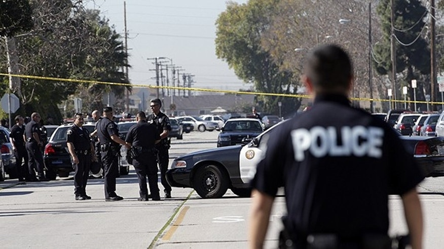 Jan. 18: A group of police officers stand outside Gardena High School in Gardena, Calif., after reports of a number of students being wounded during a shooting.