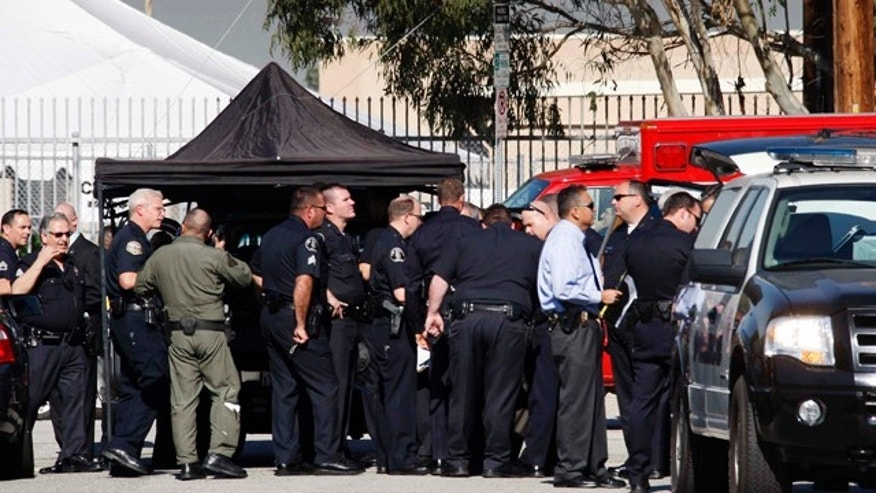 Jan. 18, 2011: Members of the LAPD gather outside Gardena High School in Gardena, Calif. According to officials, a number of students were wounded in a shooting at the school.