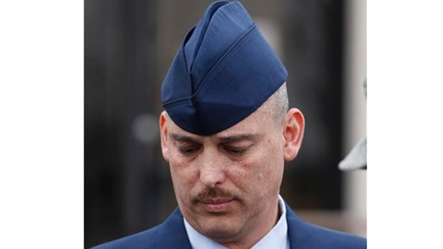 Jan. 19, 2011: Air Force Sgt. David Gutierrez walks out of the Law Center at McConnell Air Force Base in Wichita, Kan., for a lunch recess. The defense rested Wednesday for Gutierrez, who is HIV positive and is accused of exposing multiple sex partners to HIV at swinger parties.