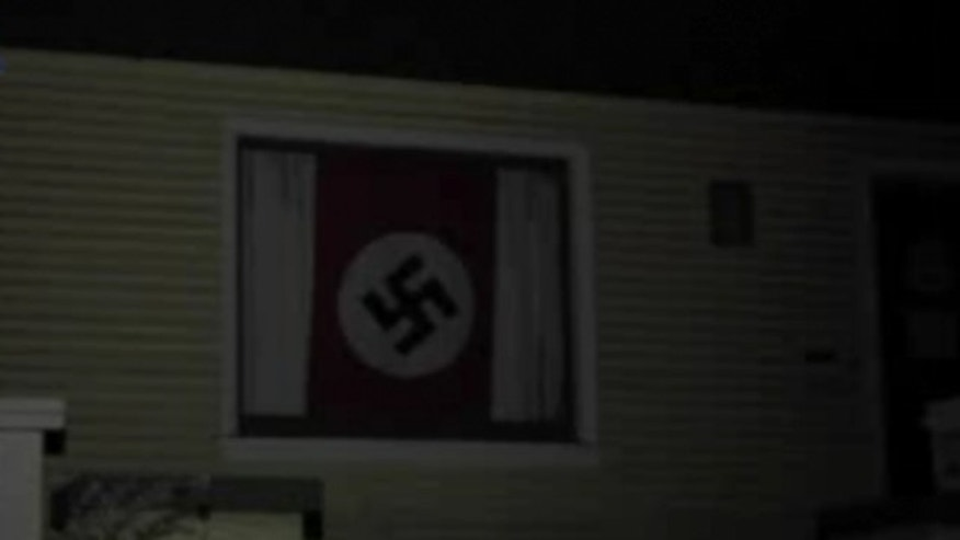The flag was on display as of late Thursday in a home on U Street between 25th and 26th streets in Sacramento, KTXL reports.  (KTXL/Fox40.com)