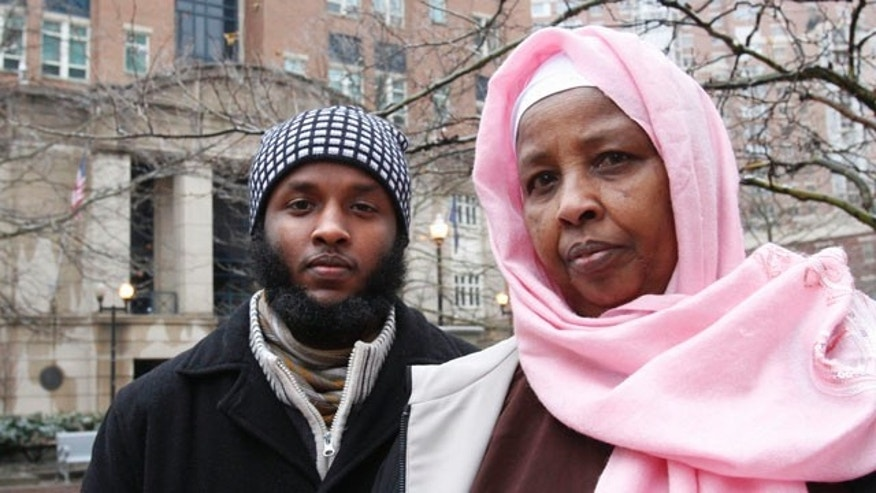 Jan. 18: Fatah Mohamed, left, and Bella Ali, brother and mother of Gulet Mohamed, pose for a portrait outside the federal courthouse in Alexandria, Va.. Gulet Mohamed been detained in Kuwait because he says the United States has arbitrarily placed him on the no-fly list, and he has filed a law suit. (AP)