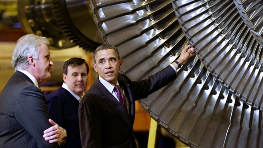 Jan. 21, 2011: President Barack Obama, joined by GE CEO Jeffrey Immelt, left, and Plant Manager Kevin Sharkey, center, visits a GE plant in Schenectady, NY