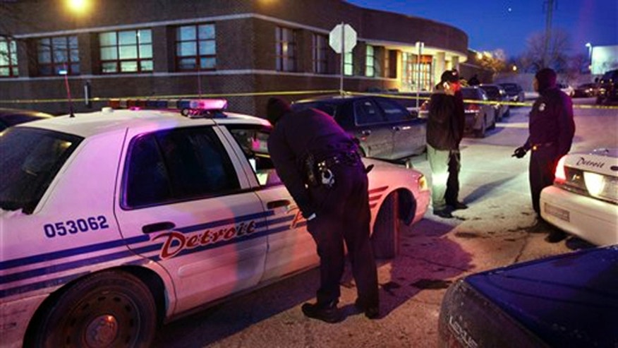 Jan. 23, 2011: Detroit police stand outside the precinct 6 building in northwest Detroit where a gunman walked into the police station and opened fire injuring three police officers.  (AP)