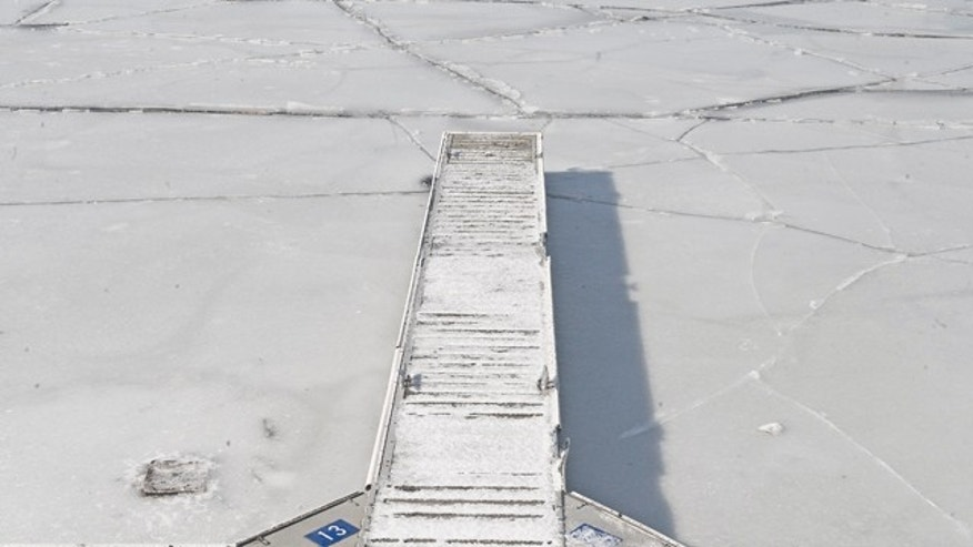 Jan. 23: A boat dock is shown in the frozen waters of the Delaware River in Camden, N.J. Gusty winds in the Garden State are bringing Arctic cold air that is expected to last into the early part of next week. (AP/Camden Courier-Post)