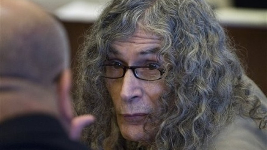 Rodney Alcala talks with his investigator before being convicted in Santa Ana, Calif. on Feb. 25, 2010, of murdering a 12-year-old girl and four women in the late 1970s (AP).