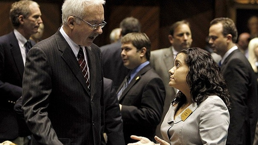 Jan. 27: After filing his bill challenging the U.S. Constitution's 14th Amendment, Rep. John Kavanagh, left, speaks with bill opponent Rep. Anna Tovar at the Arizona Capitol.