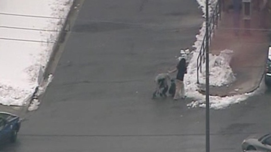 Police were able to capture the suspect, seen here, after he tripped over a pile of snow. The woman managed to escape. (MyFoxDC.com)