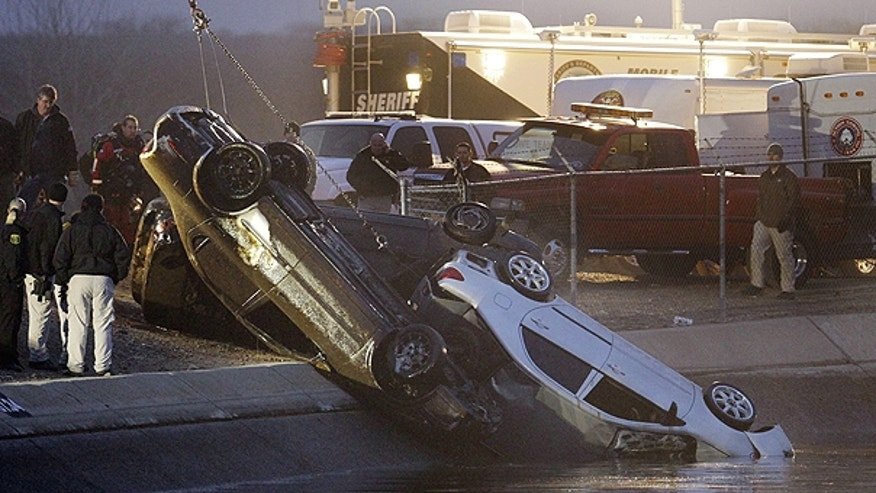 Jan. 28: Rescue workers pull up three cars from a canal in Patterson, Calif.