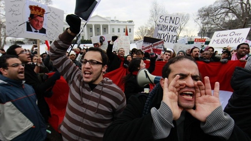Jan. 29, 2011: A crowd chants in front of the White House in Washington, demanding that Egyptian President Hosni Mubarak step down.
