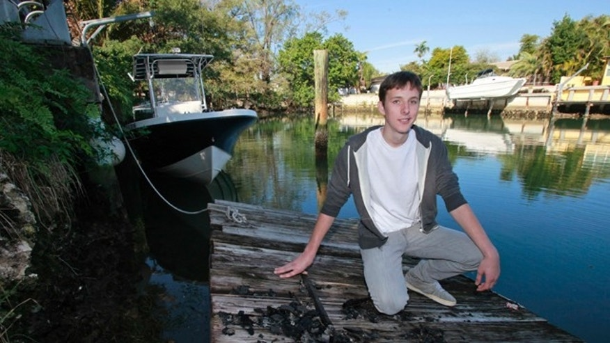 Jan 27, 2011: Nicholas Harrington, 16, poses on a dock in his back yard in Miami. Harrington, who said that he was looking to boost his art school application, took a bow for being the one behind the grand piano that mysteriously showed up on a sandbar in Miami's Biscayne Bay