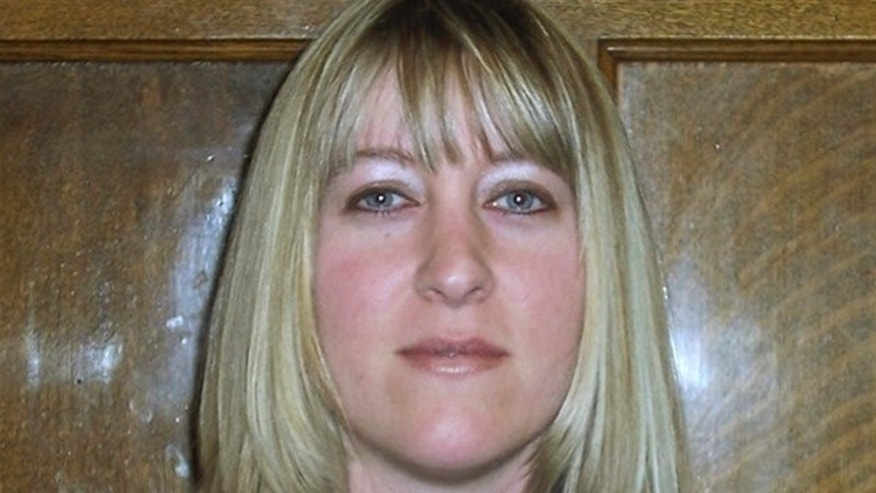 In this undated photo provided by the Washington State Department of Corrections, Corrections Officer Jayme Biendl is shown. Biendl was found strangled Saturday, Jan. 29, 2011, at the Monroe Correctional Complex in Monroe, Wash.
