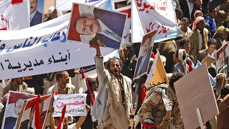 Feb. 2: Supporters of Yemeni President Ali Abdullah Saleh rally, holding his portrait, in Sanaa, Yemen, after the president said he would not seek another term in office or hand power to his son.