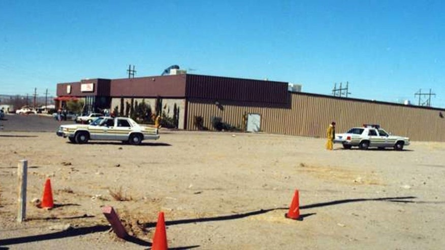 Feb. 10, 1990:This image provided by the Las Cruces Police Department shows the exterior view of the Las Cruces Bowl, where seven people were shot and four died during a robbery at the bowling alley in Las Cruces, N.M. Police are still looking for the two killers 21 years later.
