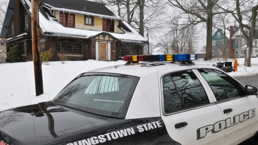 Feb. 6, 2011: A Youngstown State Police University officer patrols the street near the location of an early morning shooting at a fraternity house just north of the Youngstown State University campus that left student Jamail E. Johnson, 25 of Youngstown dead and 11 injured in Youngstown, Ohio.