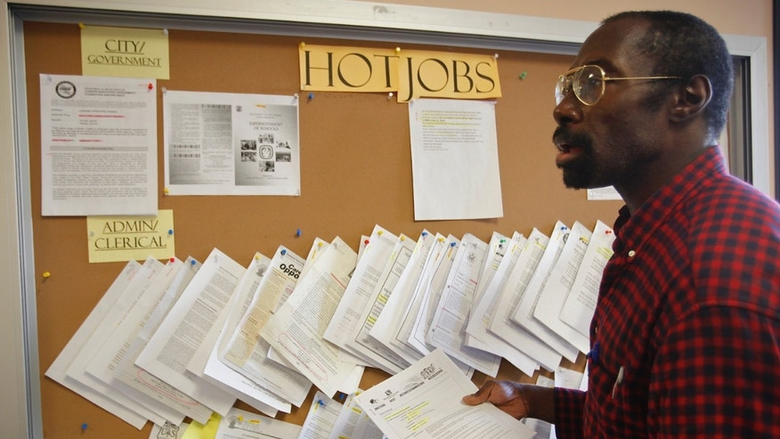 February 2011: Job seeker Richard Phillips looks for a job opportunity at the Verdugo Job Center in Glendale, California.
