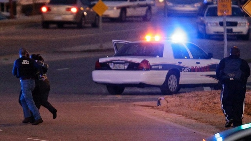 Feb. 10, 2011: Police run with a hostage at a Wachovia Bank in Cary, N.C., where an armed man took four people hostage.