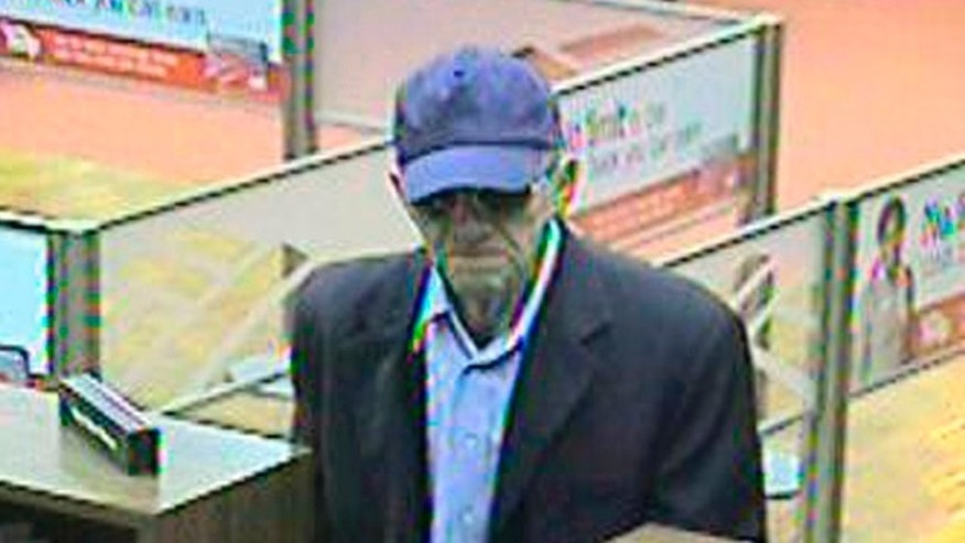 "This image provided by the FBI shows a bank robber, nicknamed, the ""Geezer Bandit"" robbing a bank in Goleta, Calif"