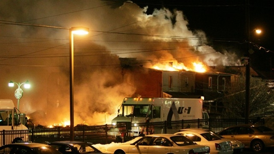 A fire rages out of control after an explosion near the intersection of 13th and Allen Streets in Allentown, Pa., early Thursday Feb. 10, 2011.