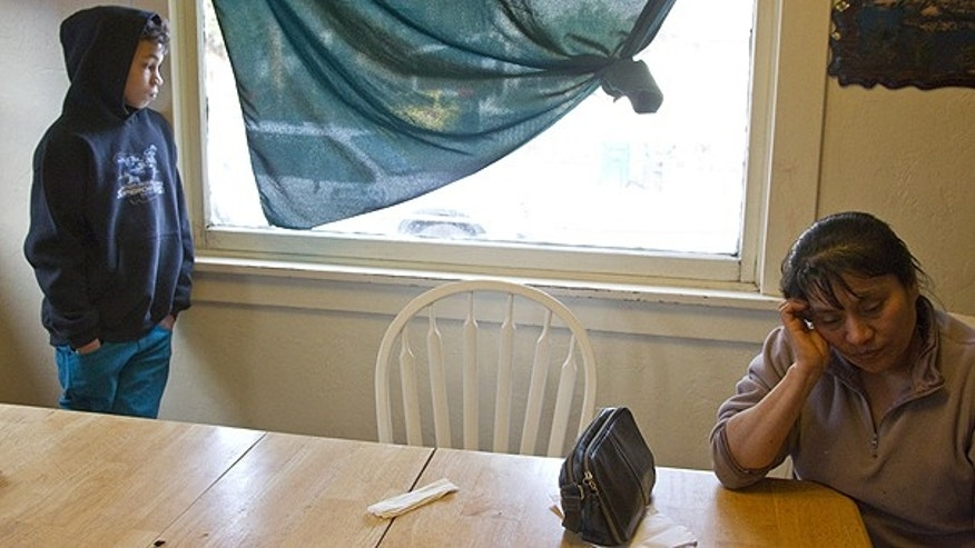 Feb. 10: Claudia Luis-Garcia gestures as she sits at a table in Portland, Ore. The death of Birgilio Marin-Fuentes, an Oregon man just feet from an emergency room has left his family in grief.