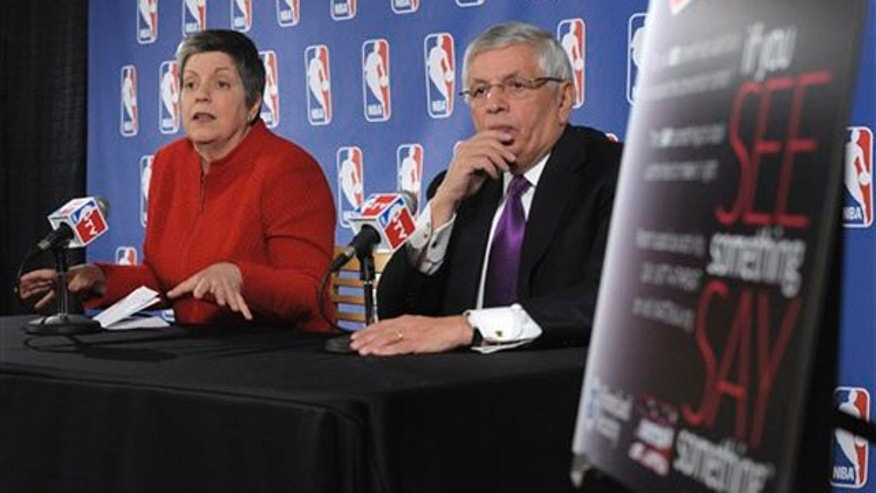 Homeland Security Secretary Janet Napolitano, left, accompanied by NBA Commissioner David Stern, speaks during a news conference at the Verizon Center in Washington, Tuesday, Feb. 15, 2011, to discuss her department's ongoing collaboration with the nation's sports industry.