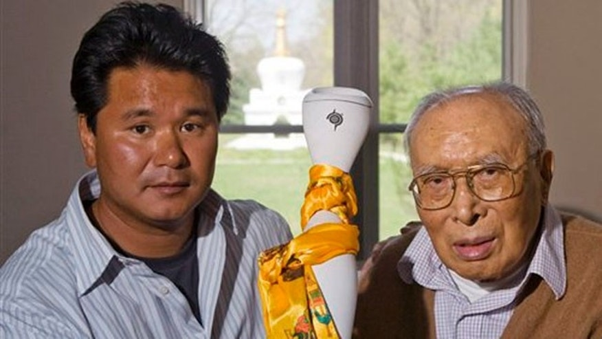 In an April 23, 2008 photo, the Dalai Lama's nephew, Jigme Norbu, left, and brother, Thubten Norbu, hold the Freedom Torch which is carried in protest of China's treatment of Tibetans, at the Tibetan Cultural Center in Bloomington, Ind. Jigme Norbu, 45, of Bloomington, Ind., was struck and killed Monday, Feb. 14, 2011 on a Florida highway at Palm Coast, while on  a Valentines Day Walk for Tibet  from St. Augustine, Fla. south to West Palm Beach, Fla. Thubten Norbu died Sept. 5, 2008.