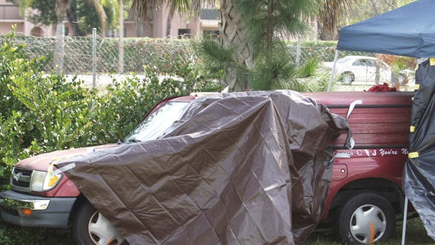 Feb. 16: A truck, covered by police, is parked on the side of I-95 near West Palm Beach, Fla., after officials discovered it was filled with toxic chemicals, a 10-year-old girl's dead body, and her severely injured twin brother.