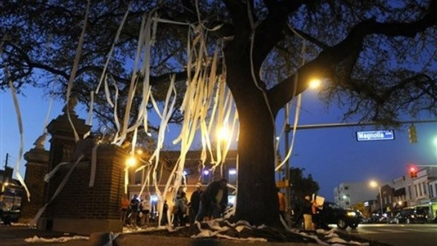 Feb. 16: Students and supporters gather to pay tribute to live oaks at Toomer's Corner on the campus of Auburn University (AP).