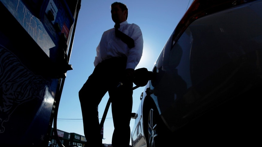 Feb. 16: Brian Sprague fills his his car's tank with gas in Philadelphia. Violent protests in the Middle East are keeping investors on edge about possible crude supply disruptions.