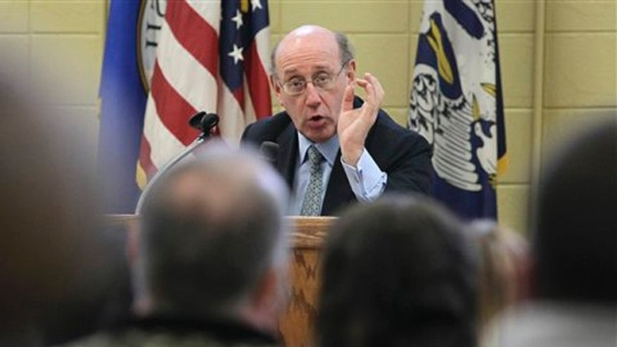 "In this Jan. 10, 2011 photo, claimants listen to BP oil spill fund administrator Kenneth Feinberg, center, as he speaks at a town hall meeting in Grand Isle, La. President Barack Obama vowed during a White House speech last June that the $20 billion he helped coax out of BP for an oil spill compensation fund would take care of victims ""as quickly, as fairly and as transparently as possible."" Eight months later, that's not how things look to many people along the Gulf Coast. An Associated Press review that included interviews with legal experts, government officials and more than 300 Gulf residents found a process beset by red tape and delay, and at the center of it all a fund administrator whose ties to BP have raised questions about his independence."
