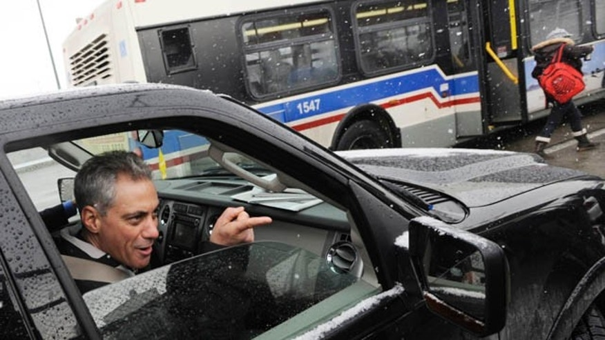 Feb 22, 2011: Chicago mayoral candidate Rahm Emanuel points to a passerby who told him that he had her vote after greeting passengers at a train station in Chicago