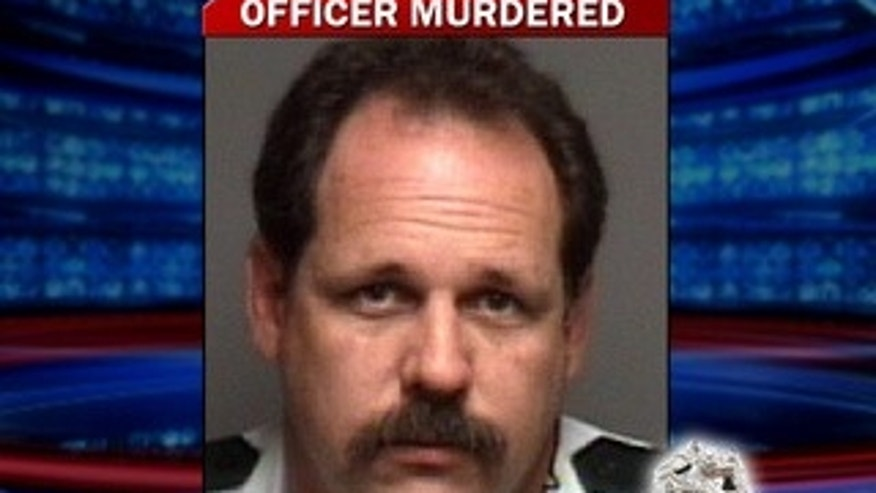 Officer David Crawford, 46 was shot and killed in St. Petersburg, Fla.
